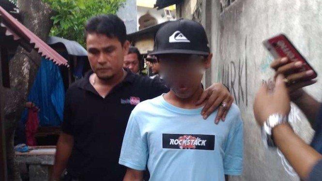 Polisi tangkap seorang tersangka kasus ujaran kebencian di Mataram, NTB (wajah disamarkan).